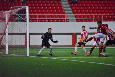 Gibraltar Football - 16th October 2015 - Last seasons league champions Lincoln won comfortably against newly promoted Gibraltar United. The seven - nil scoreline could have been double figures except for the heroic saves made by Gibraltar United keeper. Lincoln who have a bulk of the national squad as their players, having recently returned from international duty were three - nil ahead by half time.A controversial second goal in the first half saw Lincoln move ahead and increase the frequency of attacks as the Gibraltar United defence struggled to keep back Lincoln, demonstrating the divide between the top two teams and the rest of the division.